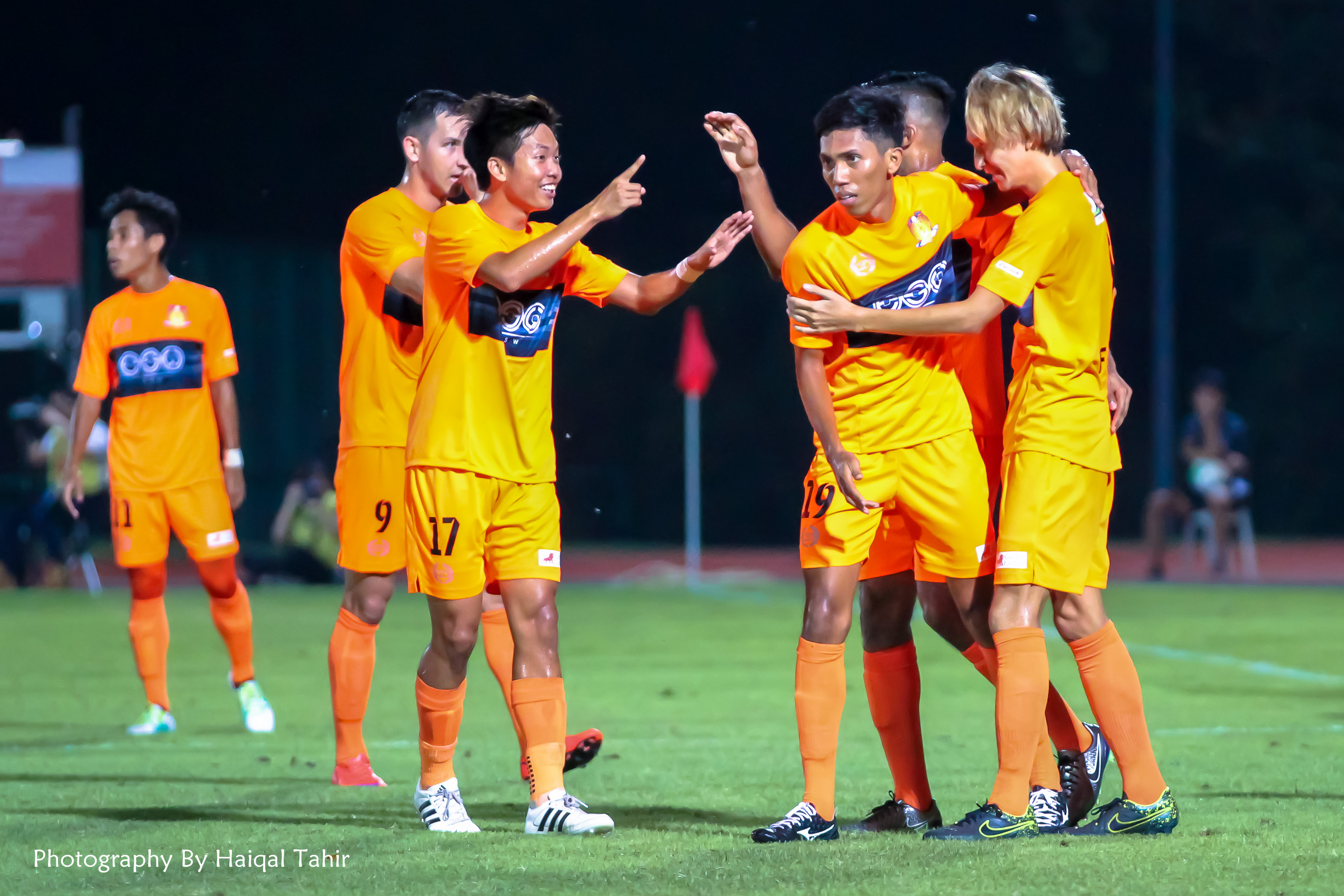 Goal scorer Fumiya Kogure celebrate with teammates.
